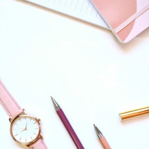 Watch, pen and notebook